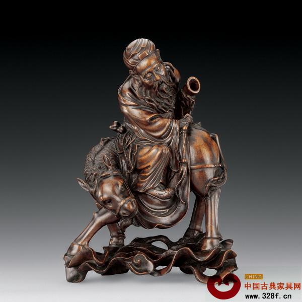 清中期的龙眼木雕作品《张果老骑驴》