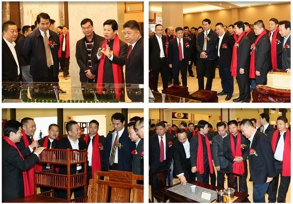 五华红木家具协会会长、五华红木文化产业园董事长张锡复带领领导嘉宾们参观五华红木文化产业园