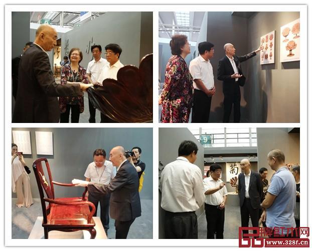 邵湘文大师向嘉宾们介绍泰和园《梅兰竹菊》君子系列的特色和创作过程