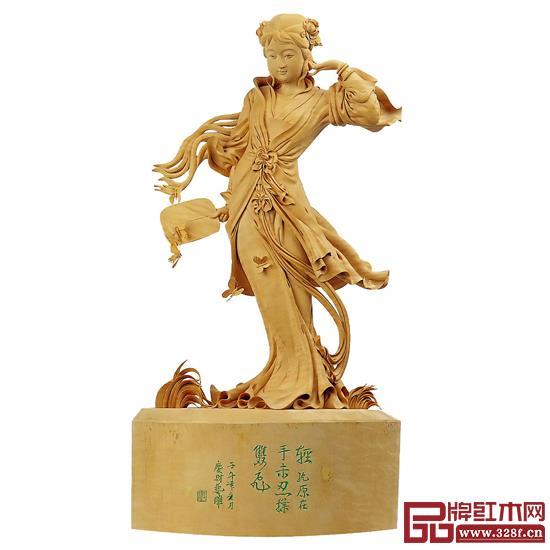 林庆财大师作品——黄杨木雕《扑蝶》,该作品于2000年被收藏于福建省工艺美术珍品馆